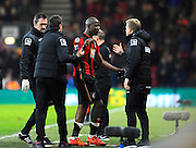 AFC Bournemouth forward Benik Afobe is substituted after picking up a knock and is congratulated by AFC Bournemouth manager Eddie Howe during the Barclays Premier League match between Bournemouth and Norwich City at the Goldsands Stadium, Bournemouth, England on 16 January 2016. Photo by Graham Hunt.