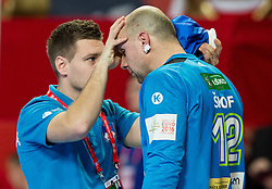 Zan Roos Rant with injured Gorazd Skof of Slovenia during handball match between National teams of Germany and Slovenia on Day 6 in Preliminary Round of Men's EHF EURO 2016, on January 20, 2016 in Centennial Hall, Wroclaw, Poland. Photo by Vid Ponikvar / Sportida