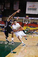 November 25th, 2010:  Anchorage, Alaska - University of Alaska-Anchorage guard Drew Robinson (1) drives in the Seawolves 54-86 loss to Weber State in the first round of the Great Alaska Shootout.