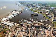 Nederland, Groningen, Delfzijl, 01-05-2013; haven Delfzijl met droogdokken en jachthaven Neptunus. Gezien naar Zeehavenkanaal (met strekdam), Eems in de achtergrond, stadscentrum in de voorgrond.<br /> Delfzijl harbor with docks and marina Neptune. In the background the Ems.<br /> luchtfoto (toeslag op standard tarieven);<br /> aerial photo (additional fee required);<br /> copyright foto/photo Siebe Swart