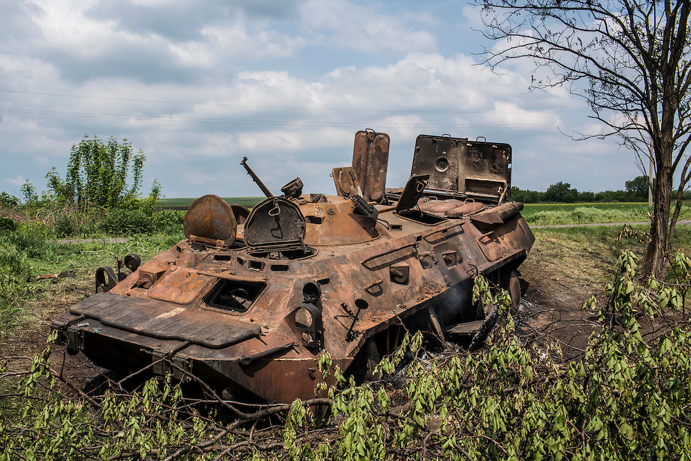 OKTYABRSKAYA, UKRAINE - MAY 14: A destroyed armored personnel carrier on May 14, 2014 in Oktyabrskaya, Ukraine. Pro-Russian militants ambushed Ukrainian troops nearby the day before, killing seven and wounding another eight in the most deady attack yet on Ukrainian forces. (Photo by Brendan Hoffman/Getty Images) *** Local Caption ***