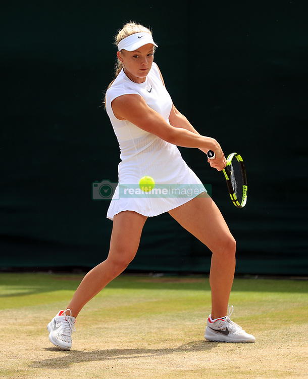 Katie Swan competes in the girls singles on day Nine of the Wimbledon Championships at The All England Lawn Tennis and Croquet Club, Wimbledon.