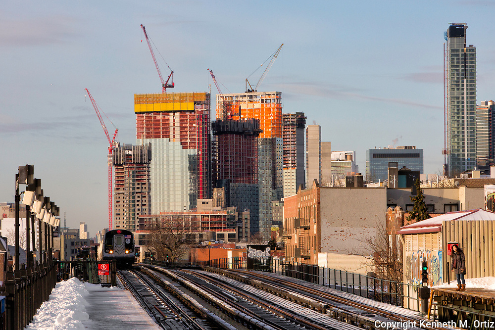 Long Island City rising in the distance. The view is from the Astoria Broadway stop on the Q & W train.