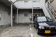 parked car in front of apartment housing Japan Yokosuka