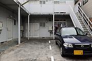 parked car in front of apartment housing Japan Yokosuka