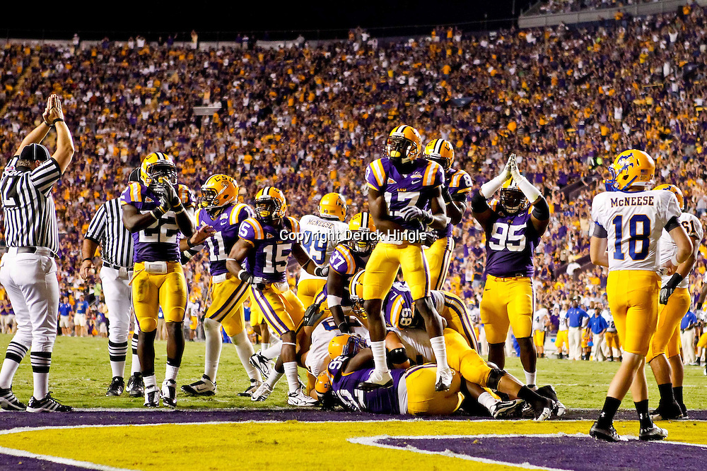 October 16, 2010; Baton Rouge, LA, USA; LSU Tigers players celebrate after forcing a safety against the McNeese State Cowboys during the first half at Tiger Stadium. LSU defeated McNeese State 32-10. Mandatory Credit: Derick E. Hingle