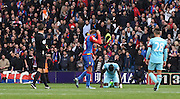 Dwight Gayle hides his head as he's sent off by Mark Clattenburg during the Barclays Premier League match between Crystal Palace and West Ham United at Selhurst Park, London, England on 17 October 2015. Photo by Michael Hulf.