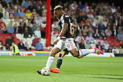 Nottingham Forest forward Britt Assombalonga (9)  with a shot on goal during the EFL Sky Bet Championship match between Brentford and Nottingham Forest at Griffin Park, London, England on 16 August 2016. Photo by Matthew Redman.