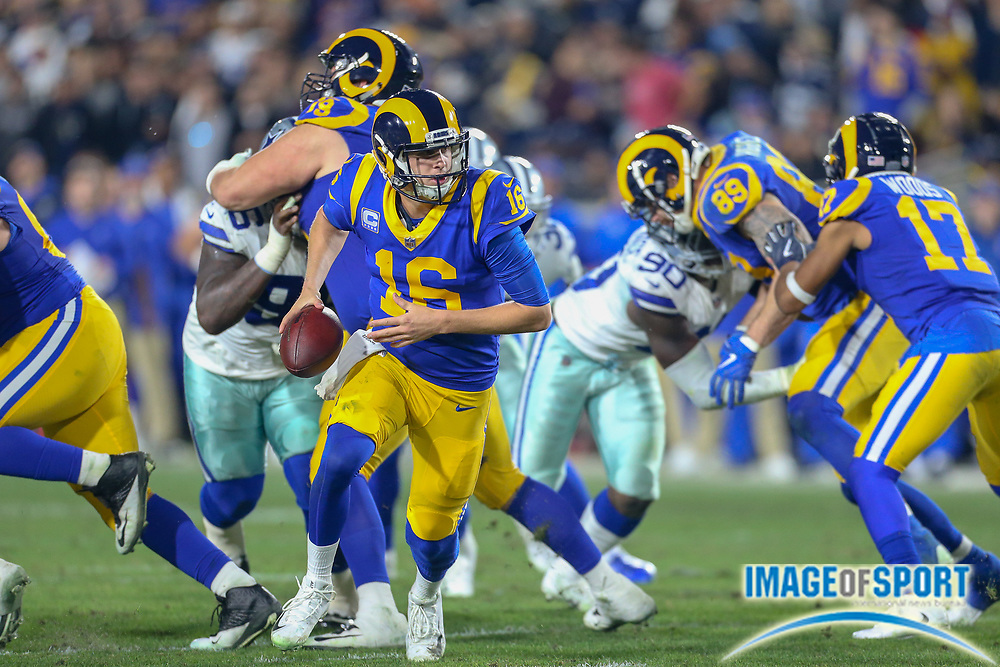 Jan 12, 2019; Los Angeles, CA, USA;  Los Angeles Rams quarterback Jared Goff (16) attempts to handoff the ball in a game against the Dallas Cowboys during an NFL divisional playoff game at the Los Angeles Coliseum. The Rams beat the Cowboys 30-22. (Kim Hukari/Image of Sport)