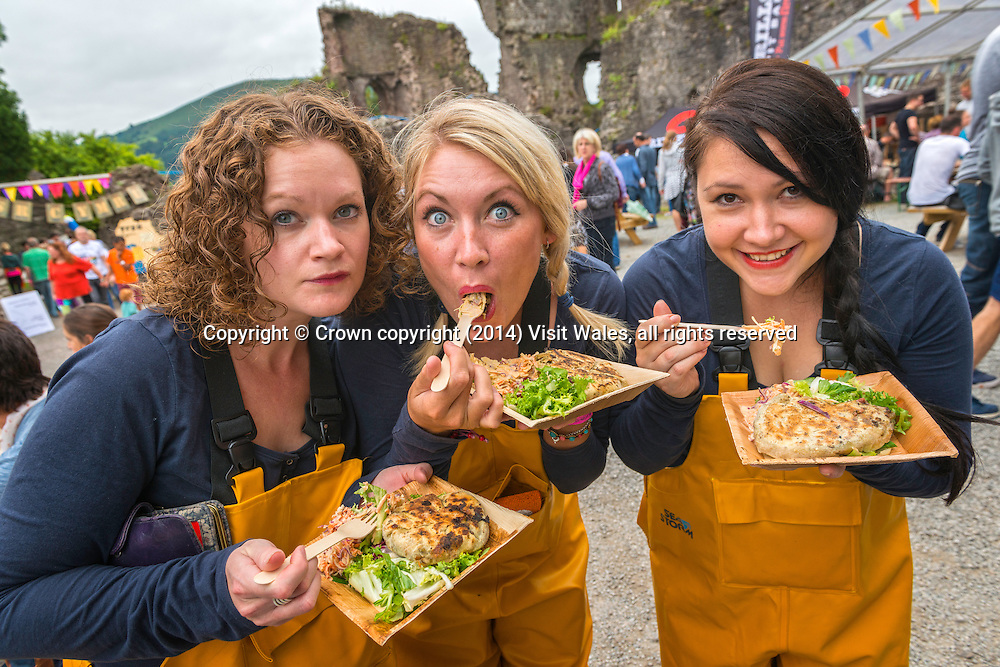 Three women eating<br /> Abergavenny Food Festival 2013<br /> Monmouthshire<br /> South<br /> Events