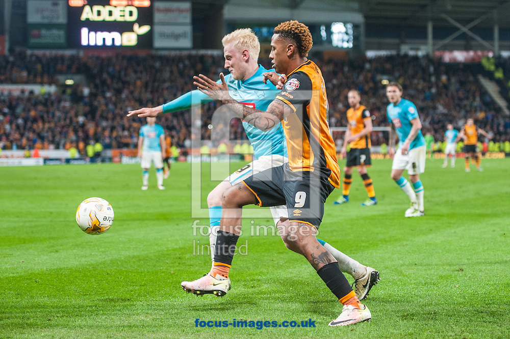 Will Hughes of Derby County and Abel Hern&aacute;ndez of Hull City battle for possession during the Sky Bet Championship Playoff Semi-final Leg Two at KC Stadium, Hull<br /> Picture by Matt Wilkinson/Focus Images Ltd 07814 960751<br /> 17/05/2016