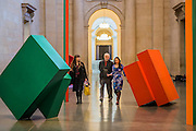 Phillip King with Call 1967, Painted steel. Phillip King exhibition at the Tate Britain, to mark his 80th birthday. The display celebrates King's significant contribution to late 20th century sculpture through six colourful sculptures. These are his key works from the 1960s and include a variety of unusual shapes and forms, demonstrate King's experimentation with abstraction, construction, material and colour. They include iconic sculptures such as Genghis Khan 1963, a conical structure with a pair of antler-like forms and Rosebud 1962, his first coloured sculpture using fibreglass. The works are displayed in the grand surroundings of the Duveen galleries at Tate Britain.
