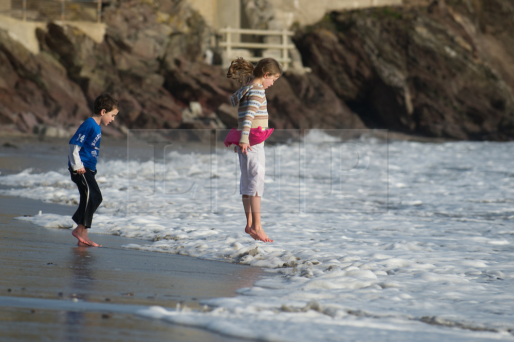 © under license to London News Pictures.  19/03/2011  Children play in the sea at Wembury beach, Devon, after a day of sun and warm temperatues. Picture credit sould read: David Hedges/LNP
