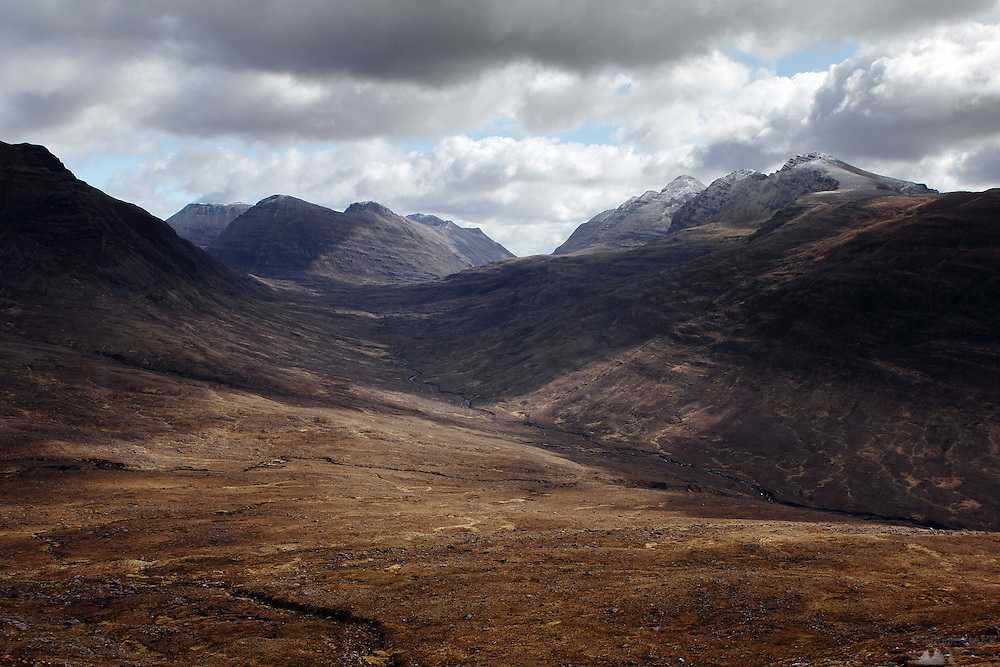 Hiking up from Torridon towards the Tom na Gruagaich munro, one of the peaks that comprise Beinn Alligin, in the Scottish Highlands. This is the view down and across to Liathach, a nearby munro.