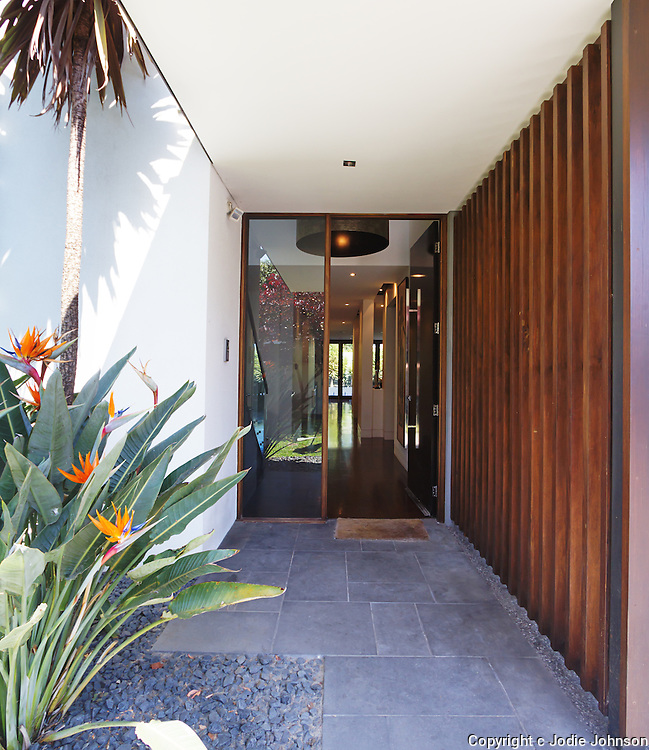 Close up of entry paving and front door of contemporary luxury Australian home