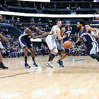 01 February 2016: Memphis Grizzlies guard Mike Conley (11) drives past Denver Nuggets guard Jamal Murray (27) on an assist by Memphis Grizzlies guard Vince Carter (15) during the Memphis Grizzlies 119-99 victory over the Denver Nuggets, at the Pepsi Center, Denver, Colorado, USA.
