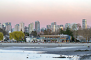 Kitsilano Beach and the Boathouse Restaurant at sunset. Photographed from Kitsilano Beach Park in Vancouver, British Columbia, Canada