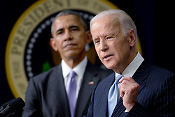 """Vice-President Joe Biden speaks as President Barack Obama looks on before signing the 21st Century Cures Act, in Washington, DC, December 13, 2016. The bill speeds up the approval process for new drugs and medical devices and expands funding for medical research, including the """"cancer moonshot"""" initiative led by Vice President Joe Biden. Photo by Olivier Douliery/ABACA"""
