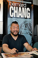 Garden City, New York, U.S. - June 14, 2014 - BERNARD CHANG an illustrator of Wonder Woman, Superman and Green Lantern comics, is at his table at Eternal Con, the annual Pop Culture Expo, held at the Cradle of Aviation Museum on Long Island.