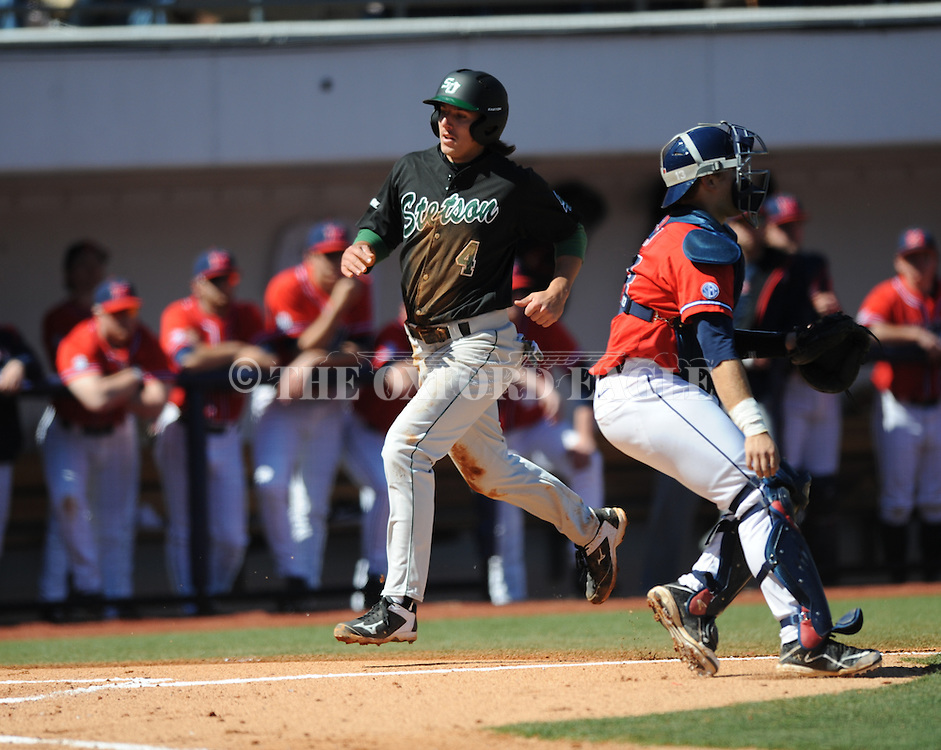 Ole Miss vs. Stetson's Colton Lightner scores at Oxford-University Stadium in Oxford, Miss. on Saturday, March 7, 2015. Ole Miss won 8-3 in game 1 of a doubleheader to improve to 7-5.