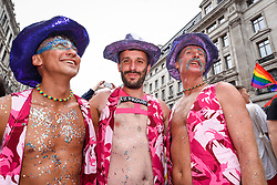 © Licensed to London News Pictures. 06/07/2019. LONDON, UK.  Men in the crowd celebrate. Tens of thousands of visitors, many wearing eye-catching costumes, gather to watch and take part in the annual Pride in London Parade, the largest celebration of the LGBT+ community in the UK.  This year's event also celebrates 50 years since the birth of the modern LGBT+ rights movement. Photo credit: Stephen Chung/LNP