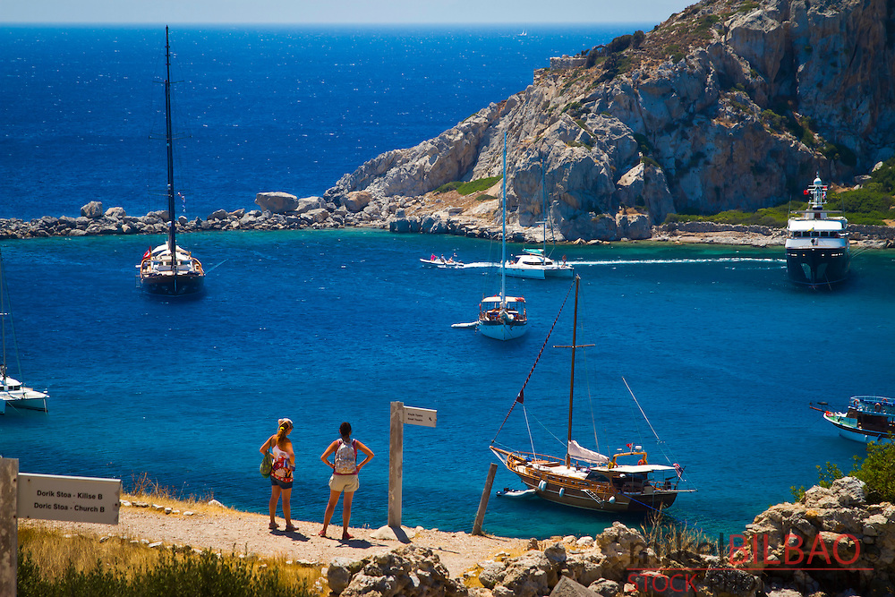 Bay and sailing ships in Knidos ancient Greek city ruins.<br /> Datca peninsula, Mugla province, Turkey.