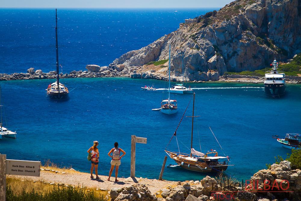 Bay and sailing ships in Knidos ancient Greek city ruins.<br /> Datca peninsula, Mugla province, Turkey.