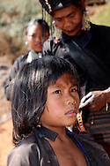 Myanmar/Burma. Boy from Eng hilltribe. Engs live in villages of the eastern part of Myanmar. They are animists and are famous for black tunics and metal armlets and blackening their teeth with betel nut and black dye.