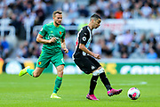 Miguel Almiron (#24) of Newcastle United plays a short pass during the Premier League match between Newcastle United and Watford at St. James's Park, Newcastle, England on 31 August 2019.