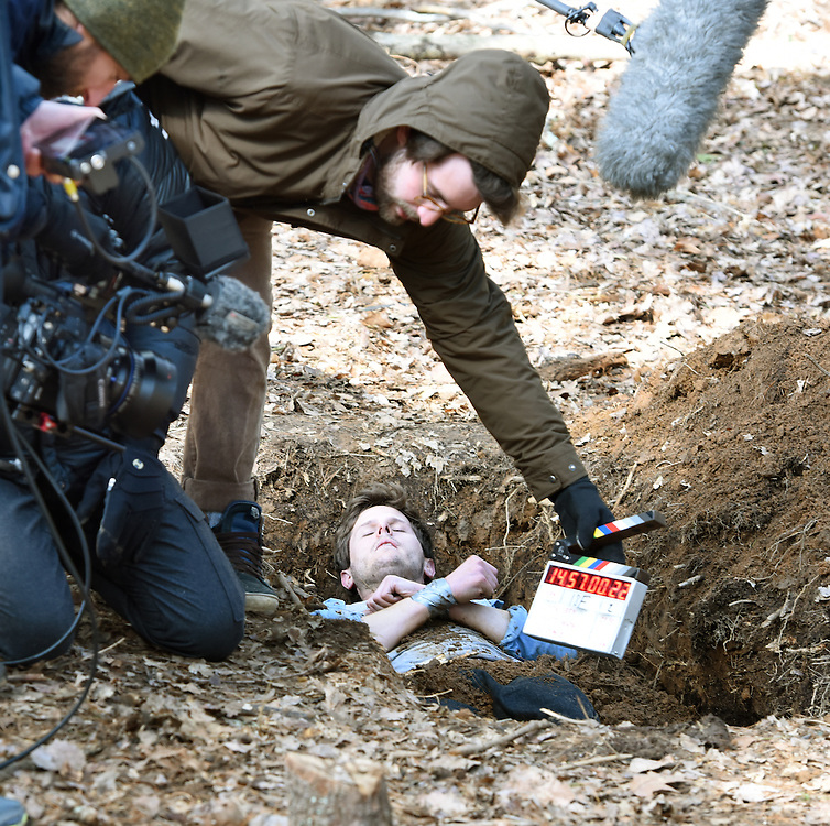 "April 5, 2016, Guilford, CT<br /> Mara Lavitt -- Special to the Hartford Courant<br /> Guilford native Matt Newton of Greenwich on his family's property in Guilford making his horror short-film ""Hide/Seek."" Director of photography Kristian Borysevicz of NYC gets ready to shoot a scene with actor Bryan Manley Davis of Brooklyn, NY in a shallow grave. First assistant camera and Guilford native Shane Rubano of NYC holds the slate."