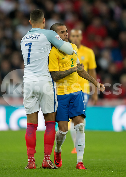 Jake Livermore of England clashes with Dani Alves of Brazil during the International Friendly match between England and Brazil at Wembley Stadium, London, England on 14 November 2017. Photo by Vince Mignott.