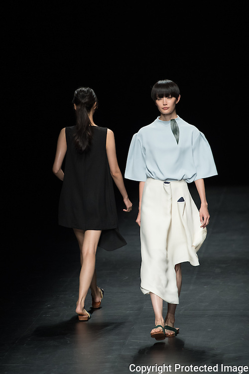 OCTOBER 23: A model  presents the Karen Topacio collection at the Amazon Fashion Week Tokyo's 2017 Spring/Summer during the Asian Fashion meets Tokyo show under way at Shibuya Hikarie in Tokyo on Oct. 23, 2016. and other locations through 23rd. Karen was born in the Philippines and grew up between Melbourne and Manila. She earned her BA degree in Communication Arts in Manila in 2006 and later graduated from an MA in Contemporary Fashion Design at IFA Paris in 2015. Her graduating show defined her signature style - innovative, graphic yet organic and playful. She was a top 20 finalist for the coveted LVMH Prize for Graduates 2015, and won the E-Fashion Awards 2015. Supported by her former school IFA Paris, Karen launched her self-titled label in June 2015. Nearly 50 fashion brands and companies will hold their shows at several locations through 23rd..23/10/2016-Tokyo, JAPAN