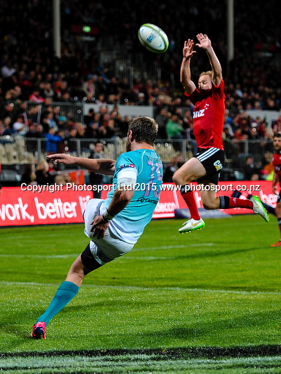Willie Le Roux of the Cheetahs kicks under pressure from Andy Ellis of the Crusaders during the Super Rugby match, Crusaders v Cheetahs, 21 March 2015 at AMI Stadium, Christchurch. Copyright Photo: John Davidson / www.Photosport.co.nz
