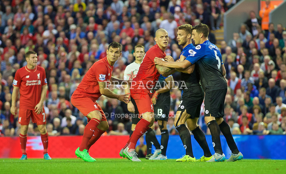 LIVERPOOL, ENGLAND - Monday, August 17, 2015: Liverpool's Dejan Lovren and Martin Skrtel in action against AFC Bournemouth during the Premier League match at Anfield. (Pic by David Rawcliffe/Propaganda)
