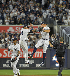 October 18, 2017 - Bronx, NY, USA - New York Yankees second baseman Starlin Castro (14) and right fielder Aaron Judge celebrate a 5-0 win against the Houston Astros during Game 5 of the American League Championship Series at Yankee Stadium in New York on Wednesday, Oct. 18, 2017. The Yankees' win gives them a 3-2 series lead. (Credit Image: © Howard Simmons/TNS via ZUMA Wire)