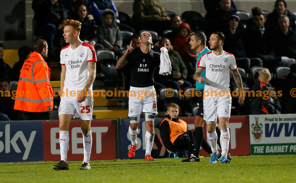Crawley&rsquo;s Jimmy Smith celebrates after scoring with a T shirt reading RIP Simmo during the Sky Bet League 2 match between Barnet and Crawley Town at The Hive Stadium in London. December 19, 2015.<br /> James Boardman / Telephoto Images<br /> +44 7967 642437