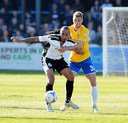 Bristol Rovers' Lee Brown challenges Dover Athletic's Ricky Modeste - Photo mandatory by-line: Neil Brookman/JMP - Mobile: 07966 386802 - 18/04/2015 - SPORT - Football - Dover - Crabble Athletic Ground - Dover Athletic v Bristol Rovers - Vanarama Football Conference