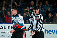 KELOWNA, BC - JANUARY 3:  Line official Cade Cooke escorts Dillon Hamaliuk #22 of the Kelowna Rockets to the penalty box after a squirmish with the Victoria Royals at Prospera Place on January 3, 2020 in Kelowna, Canada. (Photo by Marissa Baecker/Shoot the Breeze)