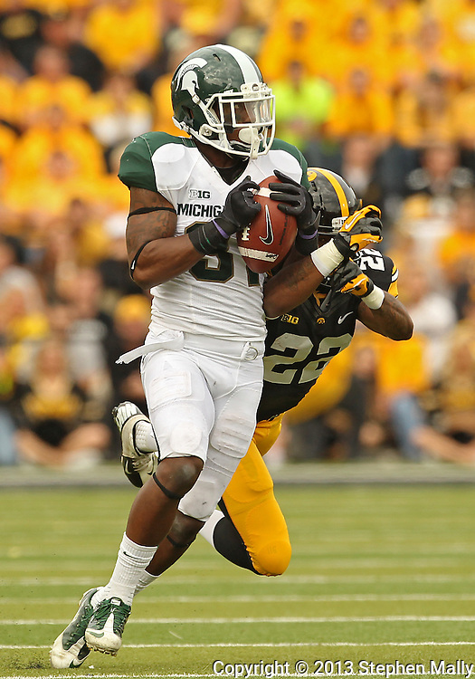October 6 2013: Michigan State Spartans cornerback Darqueze Dennard (31) intercepts a pass intended for Iowa Hawkeyes wide receiver Damond Powell (22) during the second half of the NCAA football game between the Michigan State Spartans and the Iowa Hawkeyes at Kinnick Stadium in Iowa City, Iowa on October 6, 2013. Michigan State defeated Iowa 26-14.