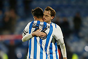 Christopher Schindler of Huddersfield Town and Richard Stearman of Huddersfield Town embrace at full time during the EFL Sky Bet Championship match between Huddersfield Town and Brentford at the John Smiths Stadium, Huddersfield, England on 18 January 2020.