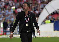 Football - 2016 / 2017 Championship Playoff Final: Reading vs. Huddersfield<br /> <br /> Huddersfield Manager David Wagner takes a solitary lap of honour whilst his players celebrate with the trophy at Wembley Stadium.<br /> <br /> COLORSPORT/DANIEL BEARHAM