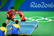 RIO DE JANEIRO, BRAZIL - AUGUST 15: <br /> <br /> Ding Ning (L) and Li Xiaoxia of China compete against Zhou Yihan and Feng Tianwei of Singapore during the Table Tennis Women\'s Team Round Semi Final between China and Singapore during Day 10 of the Rio 2016 Olympic Games at Riocentro - Pavilion 3 on August 15, 2016 in Rio de Janeiro, Brazil. <br /> ©Exclusivepix Media