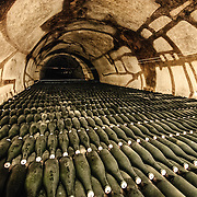 Champagne bottles stacked in cellar for aging at Pol Roger