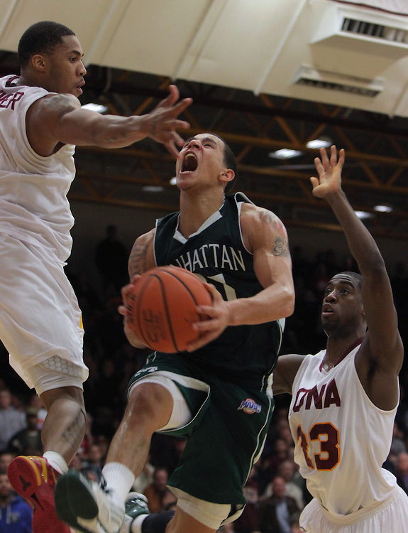 Iona's Mike Glover, left, and Randy Dezouvre, successfully defend against Manhattan College's Michael Alvarado during the last few minutes in the second half of the college basketball game at Iona College in New Rochelle on Jan. 12, 2012. Manhattan beat Iona 75-72 with a last-second 3-pointer. ( Xavier Mascareñas / The Journal News )