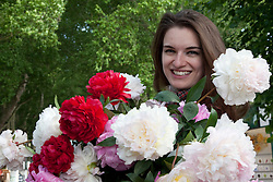 © licensed to London News Pictures. LONDON, UK  23/05/2011. Chelsea Flower Show, Press Day. Fashion model Katerina Smutok, 22, from Russia visiting Chelsea Flower Show. Please see special instructions for usage rates. Photo credit should read Bettina Strenske/LNP