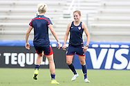 19 August 2014: Meghan Klingenberg (right) and Megan Rapinoe (left). The United States Women's National Team held a public training session at WakeMed Stadium in Cary, North Carolina.