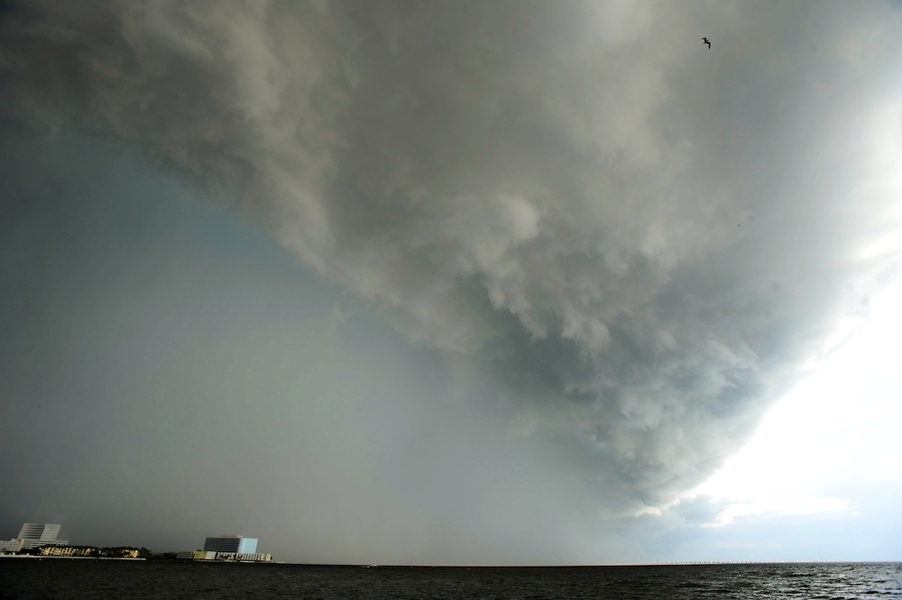 A storm cloud is seen over Old Tampa Bay while moving west toward Pinellas County Tuesday, Aug. 20, 2013 in Tampa.
