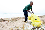 A youth participates in the beach clean up organized by Southern Durban Community Environmental Alliance (SCDEA)/KZN, 1 December 2011