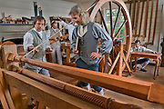 Master of the shop (on right) examining a piece of woodwork  on the lathe. Hay Cabinetmakers Shop.  18th Century scene in historic Colonial Williamsburg, Virginia. Photo by David M. Doody.
