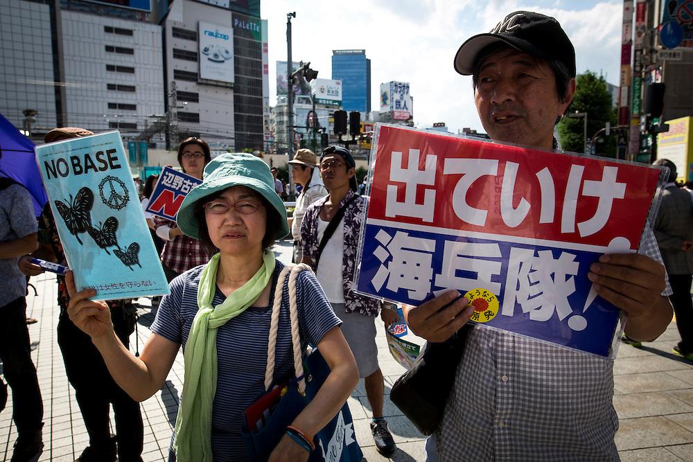 TOKYO, JAPAN - JUNE 26 : Anti U.S Airbase protesters gather during the demonstration to oppose the relocation of a U.S. Airbase in Okinawa<br />  at Shinjuku, Tokyo, Japan. June 26, 2016. Photo: Richard Atrero de Guzman